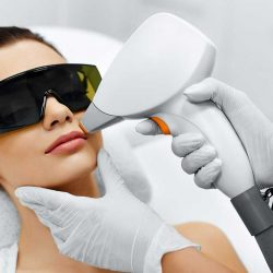 Face Care. Facial Laser Hair Removal. Beautician Giving Laser Epilation Treatment To Young Woman's Face At Beauty Clinic. Body Care. Hairless Smooth And Soft Skin. Health And Beauty Concept.